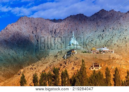 Shanti Stupa with view of Himalayan mountain and blue sky in background Ladakh Jammu and Kashmir India