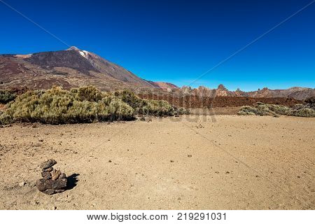 Teide National Park, Tenerife, Canary Islands colourful soil of the Montana Blanca volcanic ascent trail. This scenic hiking path leads up to the 3718 m Teide Peak, the highest peak in Spain