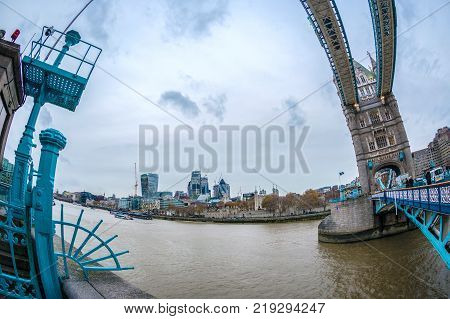 LONDON ENGLAND - NOVEMBER 27 2017: Fish Eye view architecture from Tower Bridge and London over river Thames with skyscrapers.
