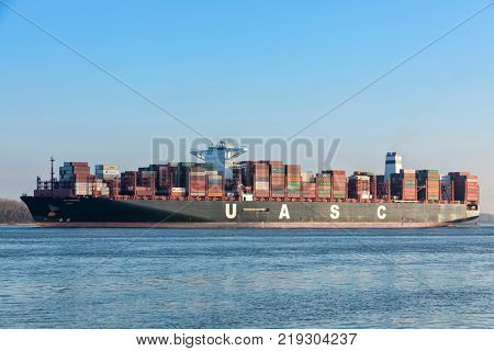 Stade, Germany - December 18, 2015: Container ship AL ZUBARA on Elbe river. The vessel is operated by United Arab Shipping Company which is owned by Hapag-Lloyd, Germany.
