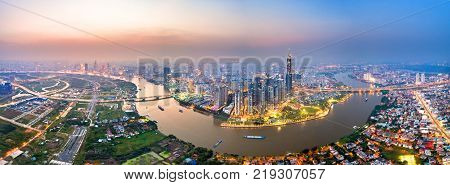 Royalty hight quality free stock image Aerial view of a beatiful skyscaper along the river light smooth down urban development near Ho Chi Minh City Vietnam. poster