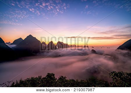 image of dawn and fog, mountains, river and rice field at Trung Khanh town, Cao Bang province, Vietnam.