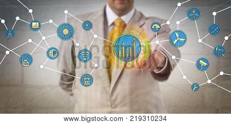 Unrecognizable corporate manager optimizing energy consumption via the Internet of Things. Information technology and sustainability concept for remote energy management over a cloud based interface.