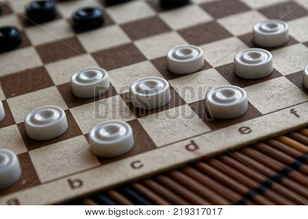 Checkers in checkerboard ready for playing. Game concept. Board game. Hobby. checkers on the playing field for a game.