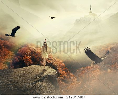 Young woman walking in her dreams enjoying beautiful autumn mountain landscape with castle on the top of the hill. Nature dreamland screen saver