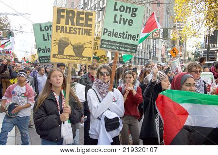 San Francisco CA - December 09 2017: More than 100 people rallied at the United Nations Plaza to condemn President Donald Trump's decision to recognize Jerusalem as the capitol of Israel