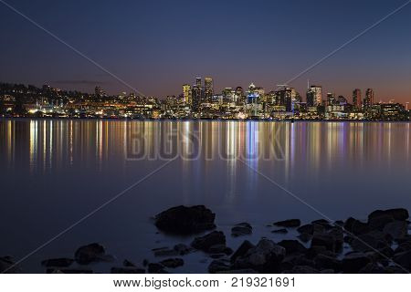 Sunset over Seattle's skyline creating colorful reflections in Lake Washington from city skyline
