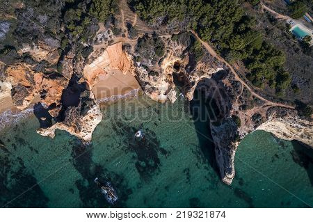 Aerial view of the coastline in the Praia do Alemao in Portimao Algarve Portugal; Concept for travel in Portugal and Algarve