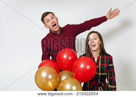 Handsome Caucasian Sad Upset Young Y Man 25-30 Years In Red Plaid Shirt With Yellow Golden Balloons,