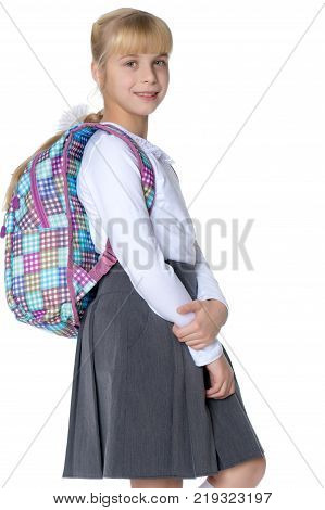 Smart girl goes to school. The concept of a happy childhood, school education. Isolated on white background.