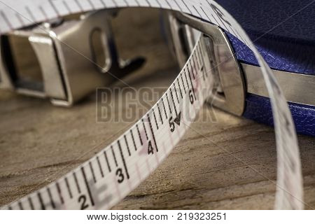Surveyors Tape Measure Close up on wooden bench
