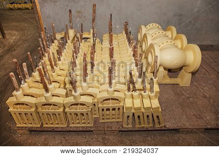 Lost-wax casting, wax pattern prepared for covering by sand ceramic. Casting foundry for producing of castings for valve, machine, automotive, train and parts for heavy industry