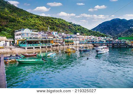 LAMMA, HONG KONG-APR2, 2016: Restaurants overlooking the sea in the small Chinese port of Lamma island on Apr 4, 2106, Hong Kong.
