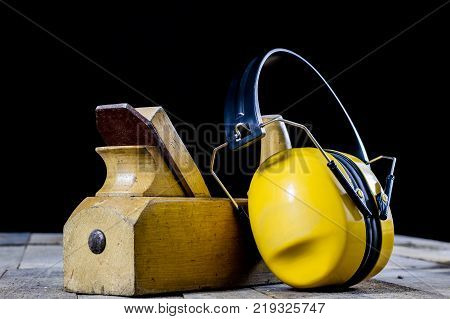 Protective Clothing On A Wooden Workshop Table. Osh Accessories In The Workshop.
