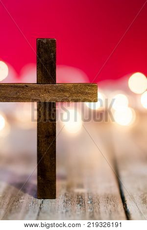 Holy Christian Wooden Cross On An Abstract Red Background