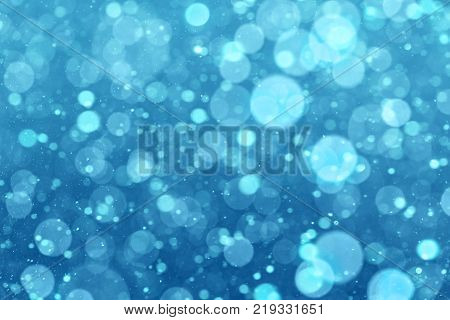Abstract winter blue background with bokeh elements