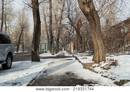 Sidewalk on the street of the old town. City's skyline. Winter landscape. Winter sidewalk.