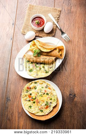 omelette chapati roll or Indian bread or roti rolled with omlet. Popular, quick and healthy recipe for kid's tiffin or lunch box