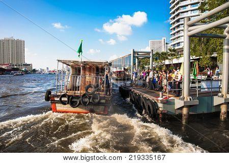 BANGKOK, THAILAN-JAN 20, 2016: River taxi view on the river in Bangkok city. River boat transporting passengers and tourist down Chao Praya river, Thailand