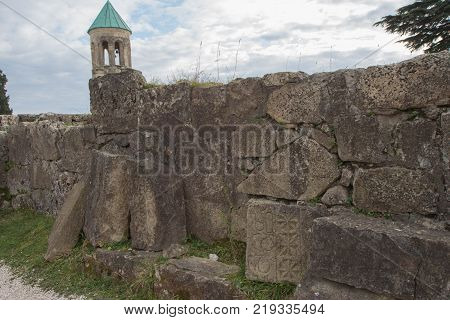 The broken city walls of the ancient Georgian city. Ancient inscriptions carved in the stone. Old Ruined Farmstead and Stone Walls