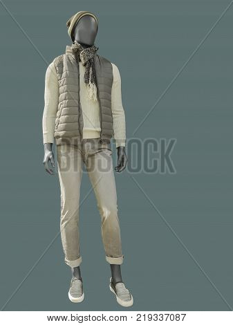Full-length male mannequin dressed in warm casual clothes isolated. No brand names or copyright objects.