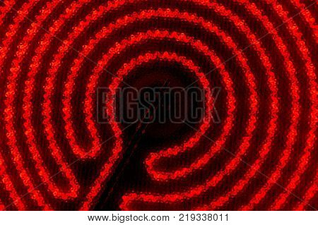 The hob of cooktop. Glowing spiral on the black background