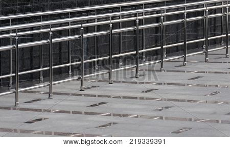 Stainless steel handrails are installed on the small bias