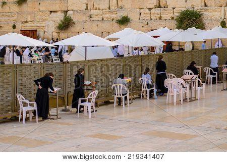 JERUSALEM ISRAEL - MAY 11 2017: Female Jews at the Western Wall for Morning Prayers. Jerusalem Israel - May 2017