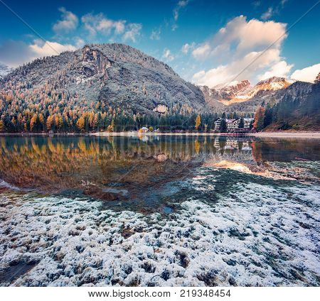 First snow on Braies Lake. Colorful autumn landscape in Italian Alps Naturpark Fanes-Sennes-Prags Dolomite Italy Europe. Artistic style post processed photo.
