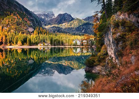 Beautiful morning on Braies Lake. Colorful autumn landscape in Italian Alps Naturpark Fanes-Sennes-Prags Dolomite Italy Europe. Artistic style post processed photo.
