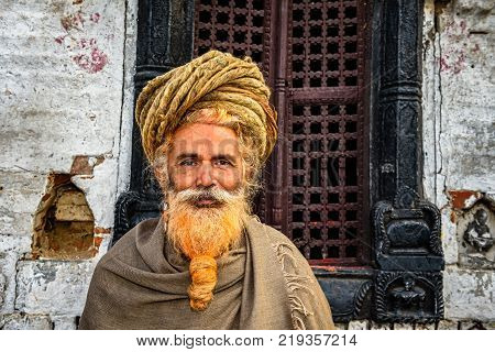 KATHMANDU, NEPAL - OCTOBER 21, 2015 : Wandering sadhu baba with traditional long hair in ancient Pashupatinath Temple