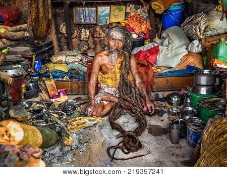 KATHMANDU, NEPAL - OCTOBER 21, 2015 : Shaiva sadhu with traditional long hair living in Pashupatinath Temple