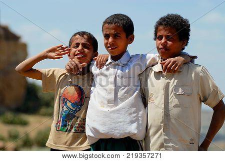 SANAA, YEMEN - SEPTEMBER 08, 2006: Portrait of three kids at the street in Sanaa, Yemen.