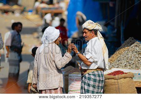 SANAA, YEMEN - SEPTEMBER 18, 2006: Two unidentified senior men talk at the street market in Sanaa, Yemen.