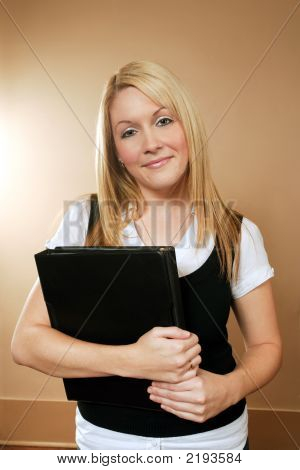 Female Holding Binders