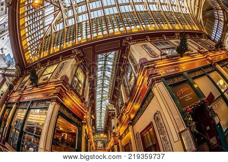 LONDON ENGLAND - NOVEMBER 27 2017: Inside of the Leadenhall market with covered roof and shopping arcade one of the oldest markets in London dating back to the 14th century.