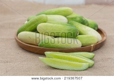 close up of fresh cucumber on sack