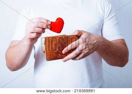 man put plush heart in the wallet concept