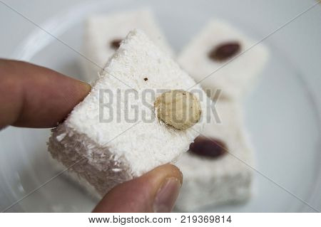 Turkish delight with hazelnut on, famous coconut Turkish delight pictures In the new year turkish delight brings a sweet luck to eating.
