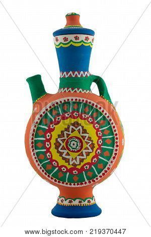 Handmade artistic pained colorful pottery jug isolated on white