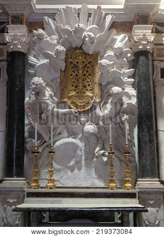 LUCCA, ITALY - JUNE 03: Altar in Chapel Cenami, high relief of Giovanni Baratta, Basilica of San Frediano, Lucca, Tuscany, Italy on June 03, 2017.