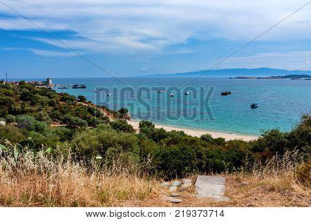 Beautiful sea view of Phospfori tower in Ouranopoli, Athos Peninsula, Mount Athos, Chalkidiki, Greece