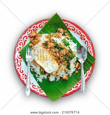 Basil Fried Rice minced pork crispy pork and Fried egg in a big tray (Thai food) isolated on whte background. This has clipping path.