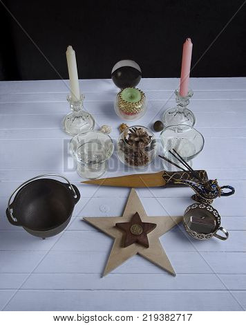 Wiccan altar for Yule, cauldron, athame and candles