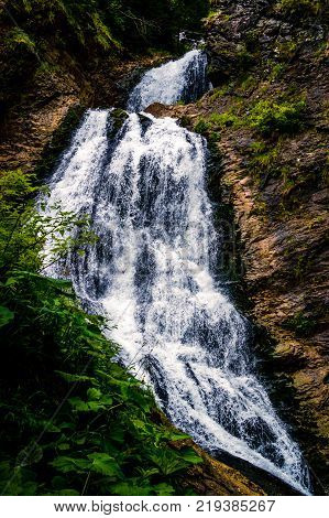 Beautiful waterfall in Apuseni Mountains, Romania. The name of the waterfall comes from a legend about a young bride who seems to have fallen off the rock on her wedding day and her veil remained hooked on the cliffs. In the very place she fell, the weddi