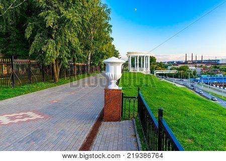 Alley along the embankment of the Izhevsk pond. Rotunda on the waterfront. Russia Izhevsk