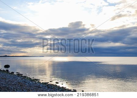 Cloudscape and sun reflections by the coast of the island Oland in the Baltic Sea
