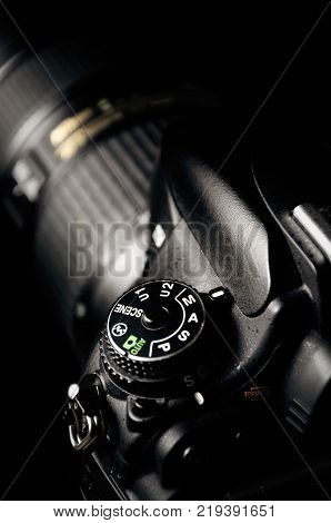 dslr camera isolated on black background. mode buttons