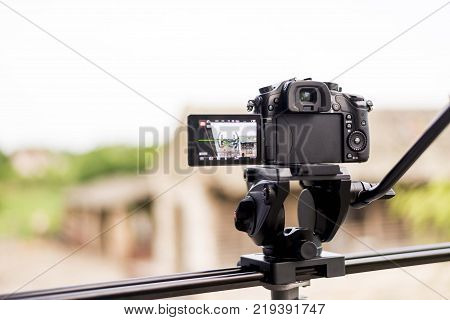 dslr mirrorless camera on tripod with video fluid head