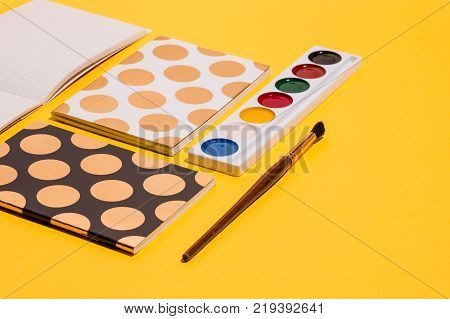 The many notebooks on colored table. The memo and planning pop art concept.